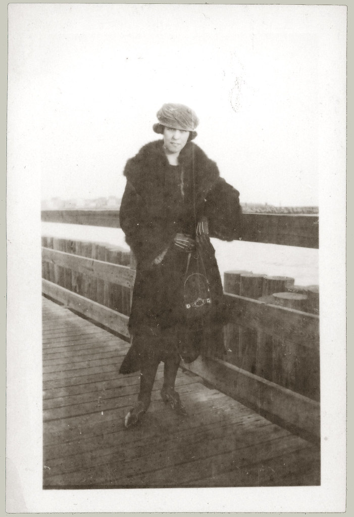 Girl in Furs on Pier