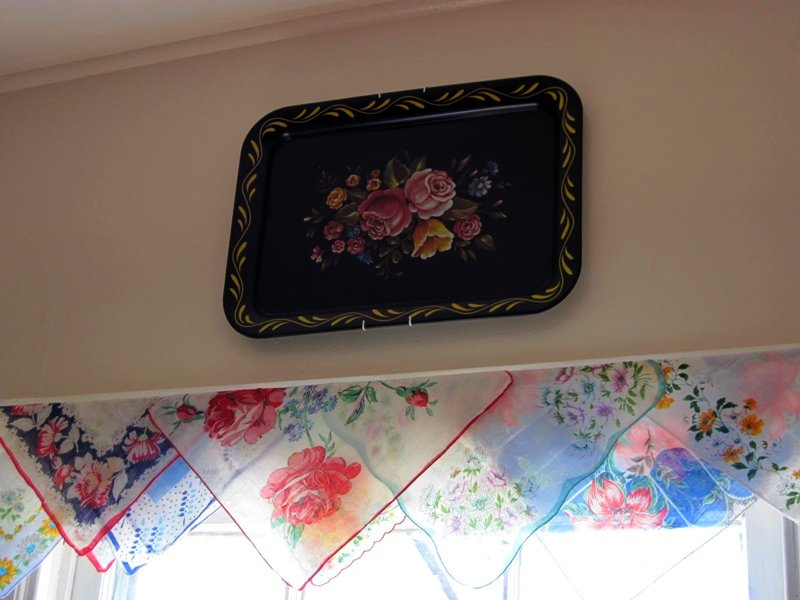 handkerchief curtains and vintage tray