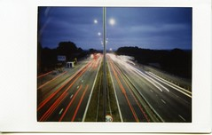 Im just standing still (themuzzy333) Tags: longexposure light cars film night toycamera mini diana instant fujifilm lighttrails instax lightstream instaxmini instantback