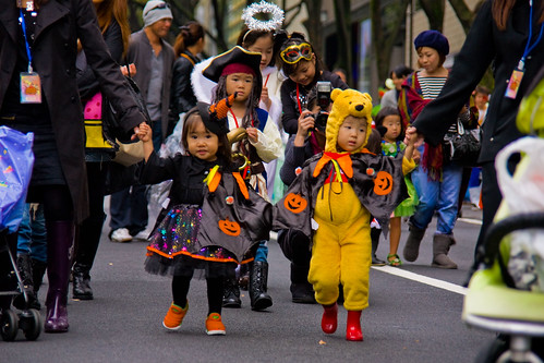 witch, pooh, and pirate. Halloween parade by Buz Carter.