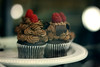 Cupcakes Make Everything Better. (ginnerobot) Tags: dessert lights cupcakes display sweet bokeh chocolate small plate latenight adventure delicious bakery raspberry swirls robinson frosting displaycase gianteagle chocolatefrosting marketdistrict marketdistrictgianteagle