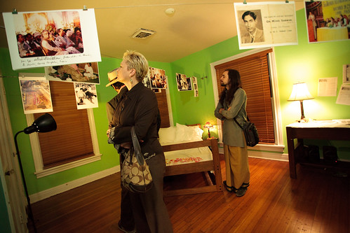 "Melaney Linton and Tyagaraja observing Sehba's installation ""Listening from Within"""