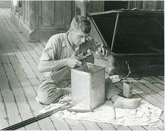 John Fant cleaning his gun on the deck of the the Cheng Ho