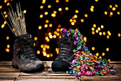 Saint Nicholas ~ Explored ~ (Sergiu Bacioiu) Tags: wood saint closeup mos shoe lights december candy boots bokeh good grunge bad dirty nicholas gifts romania rod colourful nikolaus nicolae niculae outstandingromanianphotographers