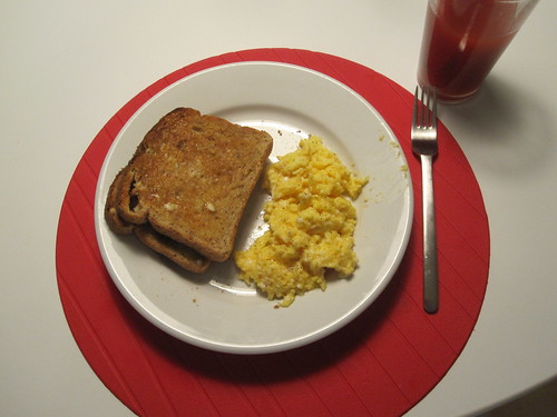 scrambled eggs, toast, tomato juice