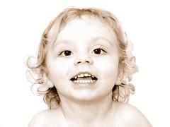 Big Smile for Dad (John Petrick) Tags: portrait smile sepia jack toddler highkey littleboy brighteyes bigsmile d90 28monthsold 18200vr longhairedboy highkeyportrait toddlerportrait smilingtoddler toddlerboy smilebig needingahaircut littleboyportrait toddlersmiling curlyhairedboy littleboysmile jackinjanuary2010 smilingfordad