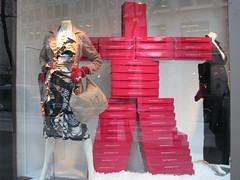 Inukshuk of red boxes in Edward Chapman window (Sherrett) Tags: window vancouver display games boxes 2010winterolympics adhack edwardchapman noticings