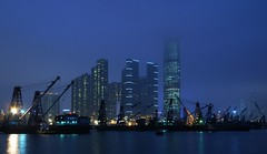 Hong Kong - West Kowloon Project (cnmark) Tags: china blue light west building architecture night clouds skyscraper buildings project square landscape geotagged ma hongkong boat construction barco ship commerce cityscape crane centre union cargo hong kong international nave hour tei area  shelter  kowloon grattacielo icc schiff barge typhoon yau reclamation wolkenkratzer yaumatei navire handling rascacielo gratteciel  arranhacu navo allrightsreserved  mygearandmepremium mygearandmebronze geo:lat=22315833 geo:lon=114154966