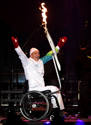 Rick Hansen with the olympic torch