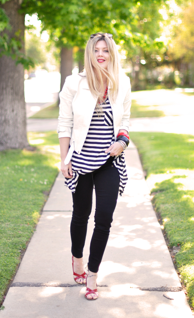 black and white striped tunic+black jeans+white leather jacket+red shoes+red lips+red accessories