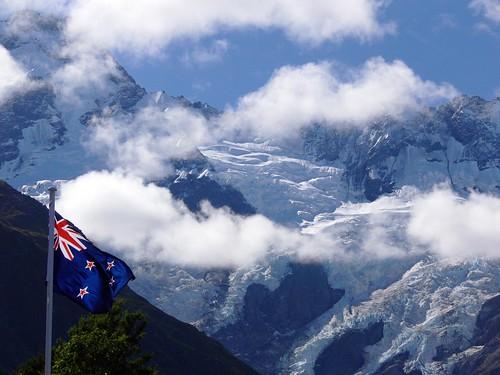 New Zealand Flag Against NZ Alps
