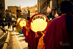 Marching.. to A Different Beat.. (SonOfJordan) Tags: street light shadow people blur colour canon eos centennial costume mood bokeh amman parade jordan beat marching xsi 450d  samawi sonofjordan  wwwshadisamawicom
