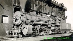 Indiana Harbor Belt Railroad 2-8-2 Mikado type steam locomotive # 260 at a coaling dock. Chicago Illinois. 1949.