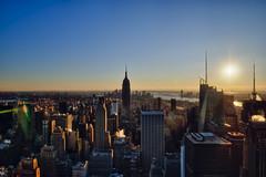 shoot the sun (mudpig) Tags: nyc newyorkcity sun newyork sunshine skyline geotagged cityscape manhattan rockefellercenter esb eastriver flare sunburst hudsonriver empirestatebuilding hdr topoftherock observationdeck mudpig stevekelley