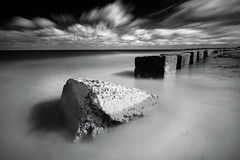 Blyth Beach Tank Blocks (Alistair Bennett) Tags: longexposure seascape beach mono coast northumberland blyth seatonsluice canonefs1022 nd110 nd30 tankblocks scuddingclouds gnd06he