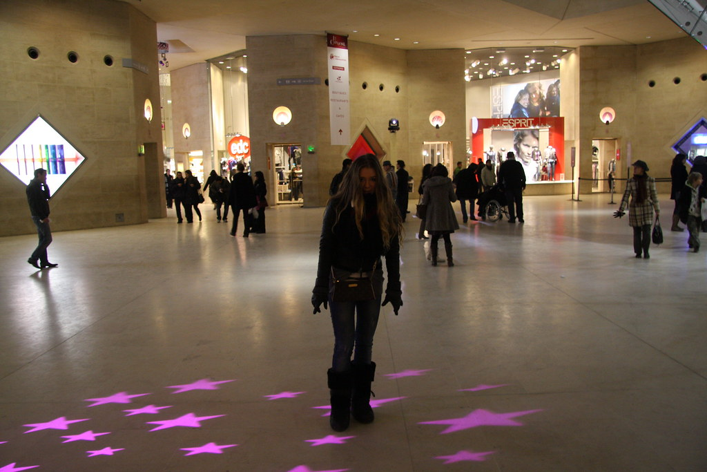 fashionable girl standing in a shopping mall