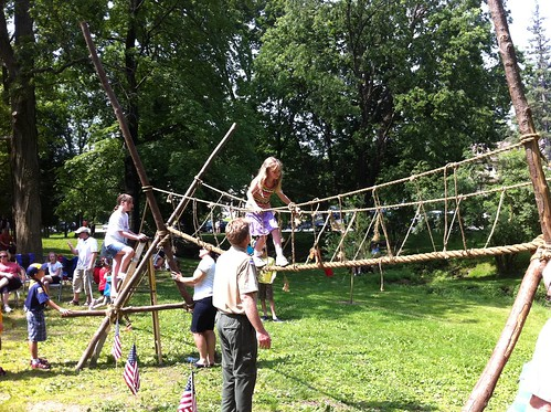 Erika crossing a rope bridge