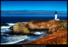 Yaquina Head Lighthouse, Oregon (szeke) Tags: ocean usa lighthouse oregon landscape us unitedstates pacific wave oregoncoast yachats yaquinaheadlighthouse breakingwave photomatix flickrsbest nikcolorefex imagenomic ultimateshot thebestofday gnneniyisi qualitypixels
