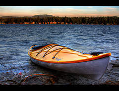 Let's Go On An Adventure (Philerooski) Tags: trees sunset sky mountain lake reflection beach nature water leaves yellow clouds trash forest boat newspaper washington focus colorful kayak waves dof horizon shoreline litter shore handheld wa stick hdr paradox crumpled diamondlake 3xp photomatix philerooski