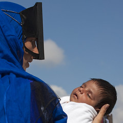 Masked bedouin mother withe her baby, Ibra, Oman (Eric Lafforgue) Tags: blue people woman baby love face kid mask head sleep religion mother hijab culture tribal bleu maternity arabia tribes souk bebe arabian masked tradition tribe niqab ethnic oman mere tribo beduin ibra bedouin ethnology tribu omn burka snaw  omani bedouine   7395 lafforgue ethnie sinaw om  omo umman  omaan  sanaw burkaburqua    omna omanas umn oman