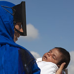 Masked bedouin mother withe her baby, Ibra, Oman