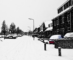 Just a tiny bit of red... (LuckMaster) Tags: street winter bw white snow black snowflakes sneeuw zwart wit hdr straat sneeuwvlokken