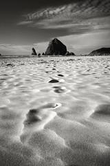 to haystack (richietown) Tags: ocean beach topv111 rock oregon canon sand footprints cannonbeach footprint 30d haystock richietown