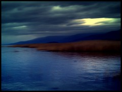 dark blue lake (maios) Tags: travel blue cloud lake color reflection water dark photo flickr foto photographer greece fotografia prespa manikis maios iosif  prespes heliography    mywinners
