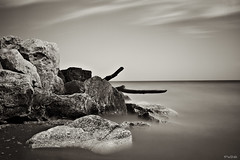 Mystify (CJ Schmit) Tags: longexposure monochrome sepia wisconsin clouds canon diy log rocks lakemichigan milwaukee toned canonef1740mmf40lusm pbcs mckinleybeach 5dmarkii canon5dmarkii cjschmit wwwcjschmitcom diypfav photographybycjschmit lincolnelectric10shade