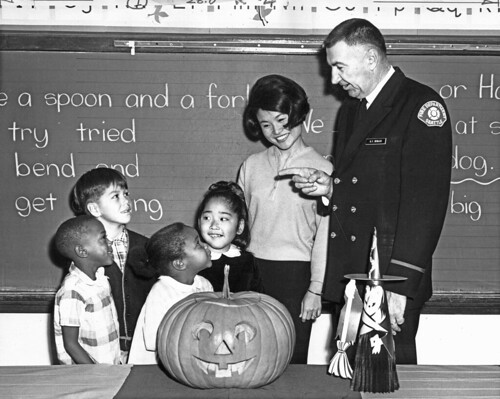Firefighter G.F. Sevilles visiting classroom at Halloween, 1966