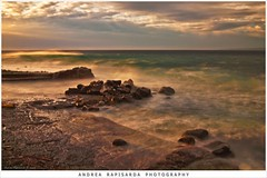 tempo di burrasca (Andrea Rapisarda) Tags: longexposure apple nature clouds sunrise geotagged dawn rocks nuvole mare waves ipod alba natura sicily burrasca sicilia onde iphone sc