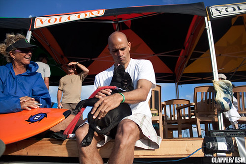 Kelly Slater gets cuddly with this dog at the Slater Invitational (photo:©Ryan Clapper ESM)