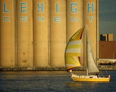 Yellow Sailboat (mlibrarianus) Tags: water sailboat boat md baltimore sail silos fortmchenry lehighcement seenonflickr