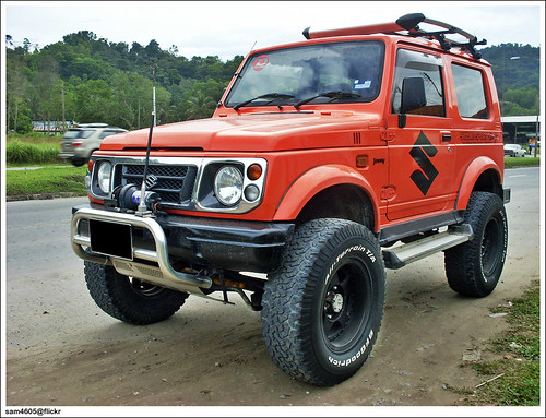 Orange Suzuki Jimny Sierra Sport