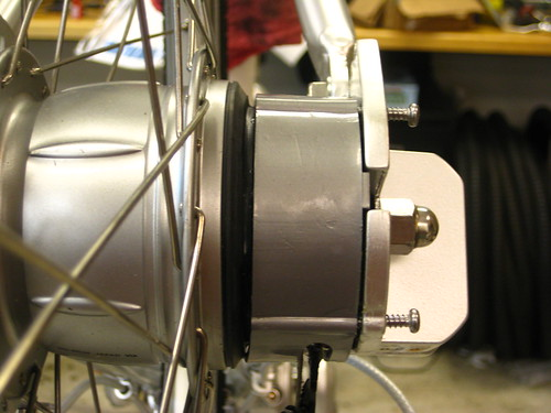 Those two unscrewed screws need to come out in order to remove the protective panel and adjust the Shimano Nexus 8-Speed Hub.