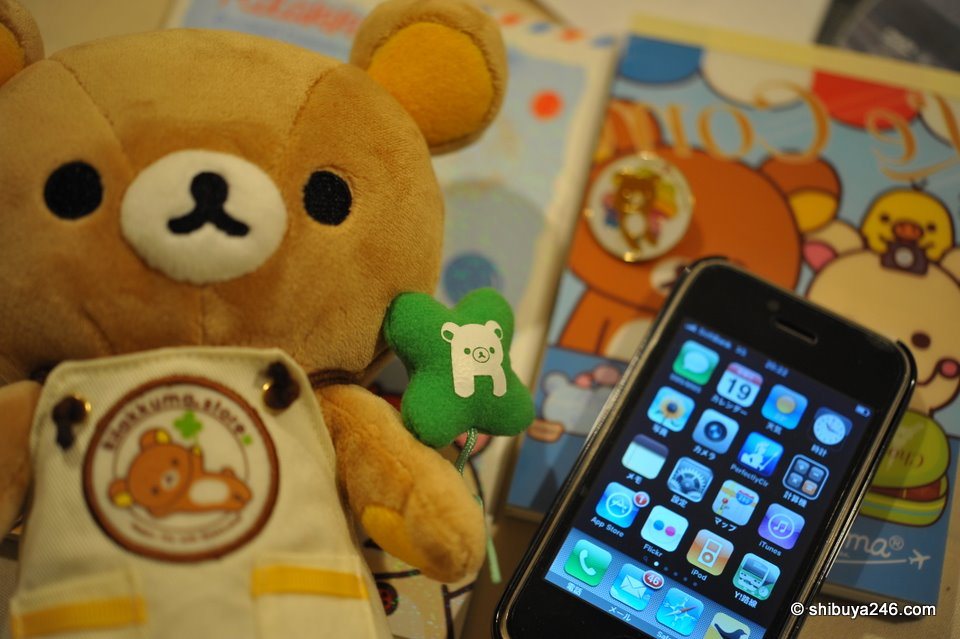 Rilakkuma with mobile phone. Looks there are a few mails to be answered there as well.
