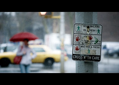 cross with care. (Vitaliy P.) Tags: street new york city nyc light red woman film wet water car rain sign yellow umbrella project movie photography drops nikon bars boulevard crossing with cross traffic candid cab taxi wide rules pole queens crop year2 gothamist 365 care cinematic raining vr month11 project365 d80 55220mm vitaliyp