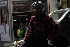 brooklyn bicyclist (omoo) Tags: street newyorkcity bike bicycle brooklyn advertisement pharmacy gloves bicyclist stoplight fulton redlight bikehelmet fultonmall busstopshelter buffaloplaid sunglasseswhite brooklynbicyclist targetnurse colorfulshoppingbags