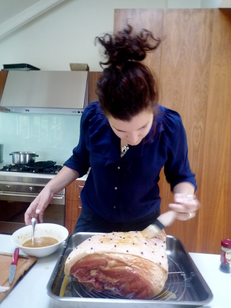 Birdie glazing the ham