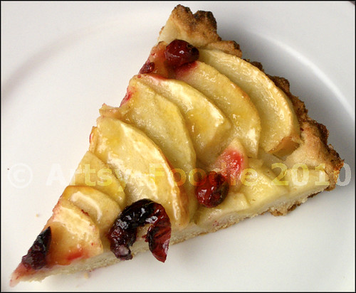Apple tart with cranberries slice
