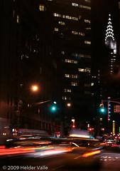 Night view of NYC (Helder Valle photographer) Tags: urban usa newyork vertical photographer unitedstates manhattan noturna northamerica colored panning 2009 fotógrafo estadosunidos americadonorte canoneosrebelxti heldervalle ©2009heldervalle