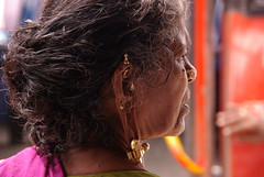 Back Home (Eric Vernier) Tags: ericvernier india tradition jewellery earing gold busstation old woman colours nofilter