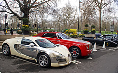 Amazing combo in front of the Dorchester hotel in London (Explore #1!) (Martijn Kapper) Tags: pink red black london car yellow hotel dubai interior united uae rollsroyce east emirates explore exotic arab middle phantom abu dhabi bugatti lamborghini dorchester matte qatar centenaire londen murcilago combo veyron  carspotting   lp640 dropheadcoupe   worldcars veyron164