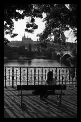 lonely (auberk) Tags: light shadow bw white black castle girl river republic czech prague praha lonely mala strana
