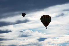 Floating into the blue heavenly skies . . . (KimFearheiley) Tags: clouds quiet peaceful hotairballoon blueskies heavenly balloonfestival statesvillenc heavenlyskies carolinaballoonfestival cpmg102309balloonfest36
