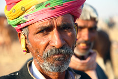 Sadness in Pushkar (... Arjun) Tags: travel pink red portrait 15fav india white green yellow 1025fav contrast 510fav sadness gold iso100 sketch asia dof sad picture dramatic 100v10f study photograph drought turban f56 pushkar 2009 description representation rajasthan portrayal likeness 105mm recession depiction rajput canonef24105mmf4lis visualrendering bluelist canoneos5dmarkii  canon5dmarkii