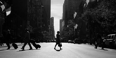 The Moment (Airicsson) Tags: street new york city nyc blackandwhite bw woman usa sun white ny black silhouette america island lumix us noir crossing cross manhattan flag flags nb panasonic moment avenue crossroads 5th et blanc fifth twop blackwhitephotos lx3 platinumheartaward