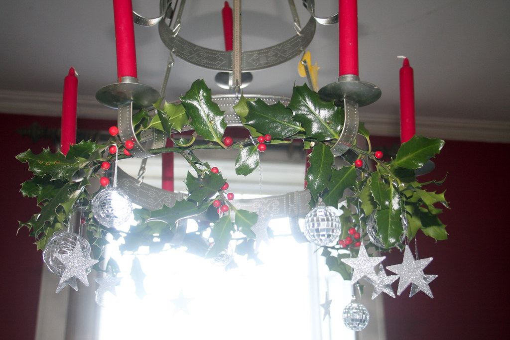 decorating a chandelier in christmas style
