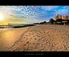approaching the winter sun [hdr] (alvin lamucho ©) Tags: ocean trees winter sea sun building beach clouds umbrella sunrise hotel apartment jetty wide perspective middleeast footprints lowtide kuwait 1022mm hdr fintas egaila rebelt1i alvinlamucho
