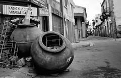 Homeless pitchers (piotr.pedziszewski) Tags: street sky sign cola homeless letters cyprus dirt rubbish shops waste pitcher coca pitchers broom nicosia
